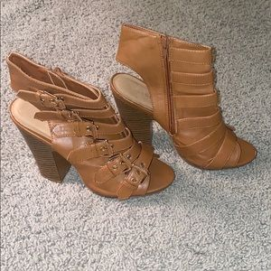Open toe booties with gold hardware.